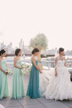Maid of honor wears a different shade of the bridesmaid's dresses to stand out just a little. love this..