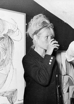 Brigitte Bardot at a Dussart art show, 1962.