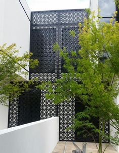 QAQ's laser cut decorative screen known as 'Valencia' is a beautifully modern, intersecting and overlapping circular pattern. This design has a su. Valencia, Decorative Screen Panels, Laser Cut Screens, Patio Wall, Metal Screen, Outdoor Material, Screen Design, How To Make Light, Residential Architecture