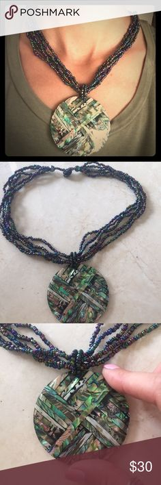 Gorgeous tiled abalone pendant Handmade in Bali, gorgeous abalone tiles disc pendant set in resin form. Featuring seed bead necklace with button back closure for a universal fit. Gorgeous handmade piece. Happy shopping! handmade Jewelry Necklaces