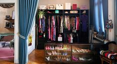 A room completely dedicated to clothing with a display case full of shoes and blue ceiling-high velvet curtains with the golden Beaumont hanging flowerpot from MADE. Vanity Shabby Chic, Shabby Chic Vintage, Shabby Chic Wallpaper, Shabby Chic Wall Decor, Shabby Chic Pillows, Shabby Chic Curtains, Shabby Chic Baby Shower, Chic Bedding, Shabby Chic Living Room