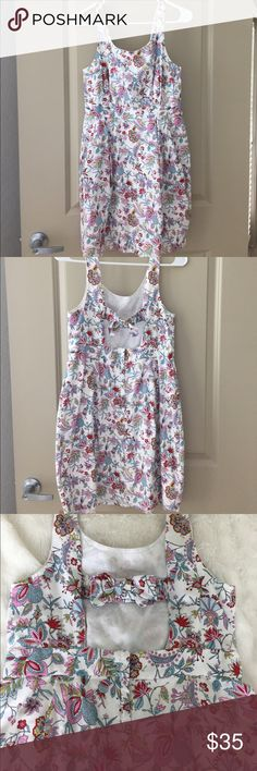 {Jack Wills} floral dress Worn once, in perfect condition. Really cute cutout and bow in the back, and also has pockets! Size is UK 12, US 8. Waist is 14.5in, shoulder to hem is 34.5in. Jack Wills Dresses