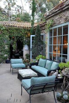 pretty patio black iron furniture, pale blue cushions by sweet.dreams