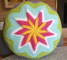 pinwheel pillow updated free pattern. I have an older vintage version from thrift store and it's interesting to see the changes they made.