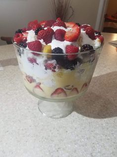 2 small boxes of Sugar free pudding, your choice of flavor.  I used banana cream.tnis time.  Large container of cool whip, 1 Sugar free angle food cake and fruit of choice.  I used strawberry, red raspberry, black raspberry and some fresh pineapple.  Make up pudding and start layering