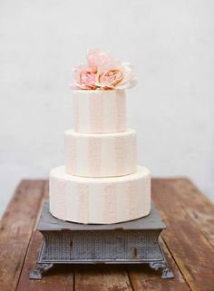 pale pink and white striped cake