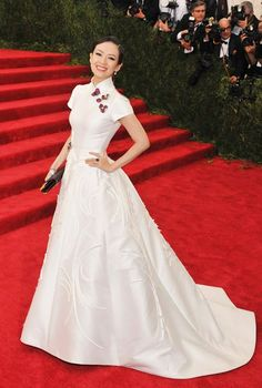 Met Moments: Zhang Ziyi is majestic in mikado at the #MetGala in custom #CarolinaHerrera ivory ball gown with a cheongsam inspired collar