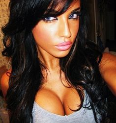 Tan skin, dark hair, flawless make up...but the cleavage is NOT cute!!!