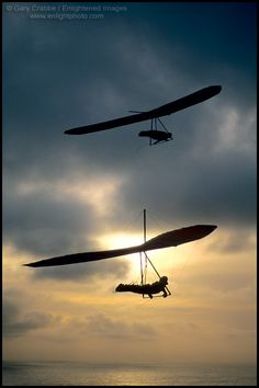 Pair of Hang gliders at sunset over the Pacific Ocean, from Fort Funston, San Francisco, California
