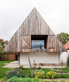 gens conceals contemporary disneyland home in traditional gabled roof