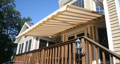Durasol Retractable Patio Awning in yellow from Innovative Openings. Visit our Louisville, CO showroom or call 303-665-1305.
