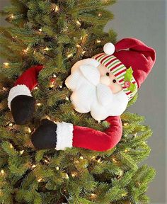 We are in love with these Christmas tree huggers! They're not the traditional Christmas tree toppers, very unique and kids love them! Elf Decorations, Elf Christmas Decorations, Cool Christmas Trees, Holiday Tree, Christmas Tree Toppers, Christmas Tree Ornaments, Christmas Holidays, Christmas Wreaths, Christmas Crafts