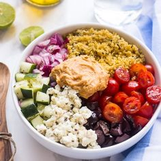 This Mediterranean Quinoa Salad Bowl is loaded with delicious and filling veggies and topped with creamy hummus in 20 minutes!