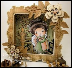 handmade card: Kimono Marci with Fan ... luv the gorgeous die cut frame, leaves and sakura ... lovely shades of brwon and olive ... lovely Copic coloring  ... diorama style card with lots of depth ... perfect for display ... La La Land Crafts ...