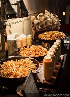 What could be more delicious then a French fry station?! Offer a variety of fries from curly to waffle to sweet potato and don't forget the condiments! Check out other 9 Food Station Ideas Guests Will Go Crazy For: http://www.colincowieweddings.com/food-and-drink/10-food-station-ideas-guests-will-go-crazy-for
