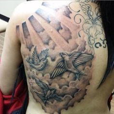 Birds flying in the clouds tattoo Its a good day when the sun is shining through the clouds.