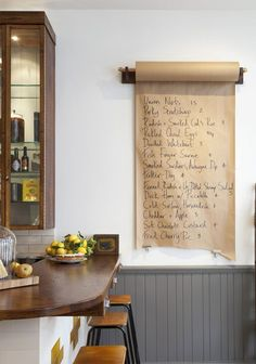 For a more sophisticated project, attach wood brackets onto a backing board and place the brown paper roll on a length of dowel that fits into the brackets