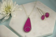 Pink teardrop pendant with matching earrings