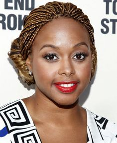 Chrisette Michele's amber micro-braids are fiercely hot. If you've been wanting to play around with a new, bold hue for your vacation, micro-braids are the way to go.