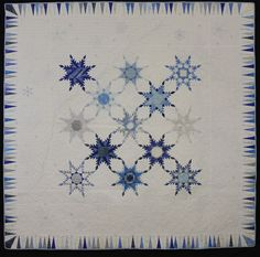 """""""Snowflake"""" quilt by Lynda Nikolovski. Blue and white feathered stars.  1st place bed quilt.  Canberra Quilters (Australia)  2013 show."""