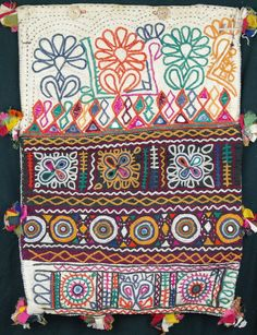Vintage Rabari dowry bag, wooden buttons, would make great cushion. 35cm x50cm http://worldbasket.co.uk/product-category/antique-and-vintage-textiles/