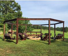 This is the perfect outdoor retreat for summer! (and spring and fall too!) Get the full detailed tutorial for this awesome porch swing pergola-style structure with a firepit and add-on movie screen option.