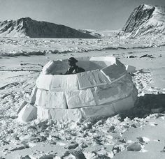 Real Snow Fort?: Eskimo constructing a domed igloo out of blocks of snow