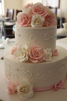 Vintage-inspired wedding cake with white and blush pink wedding flowers #wedding…