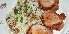 Solomillo de cerdo envuelto en bacon con arroz y setas.