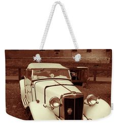 """Retro Auto Weekender Tote Bag (24"""" x 16"""") by Marina Usmanskaya.  The tote bag is machine washable and includes cotton rope handle for easy carrying on your shoulder.  All totes are available for worldwide shipping and include a money-back guarantee.  #MarinaUsmanskayaFineArtPhotography ,MG Car, Retro,Auto, sepia,Ferrara,Italy,tote bag"""