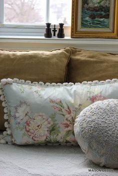 Mix and match pillows for a personal and cozy look in a bedroom window seat.  We love the buttoned down linen pillows mixed with the floral and embroidered options at HomeGoods.  Sponsored pin by Happy by Design