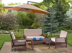 Outdoor Patio Sets With Amazing Umbrella above Table and Chairs