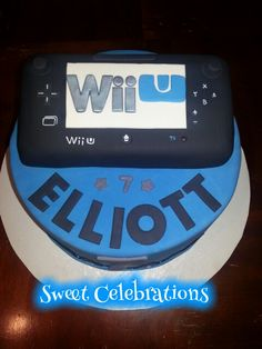 Wii U cake; vanilla cake with fresh strawberries and light whipped frosting.