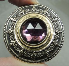 BRASS GAY 90'S BUTTON W/ FACETED AMETHYST GLASS JEWEL   METAL