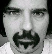 """If I can get passed the fact that this guy looks like a porn star from the '70s with that """"come hither"""" look in his eyes, I might be able to handle this mustache. After all, I bet he could make all my Batman dreams come true. I can hear it now… """"Come ride on my batmobile baby. If you're a good girl, I'll even let you wear my cape."""" hahahaha"""