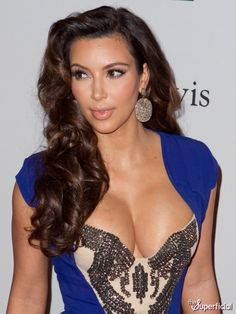 Kim Kardashian Wearing Bold Copper Diamond Circle Earrings