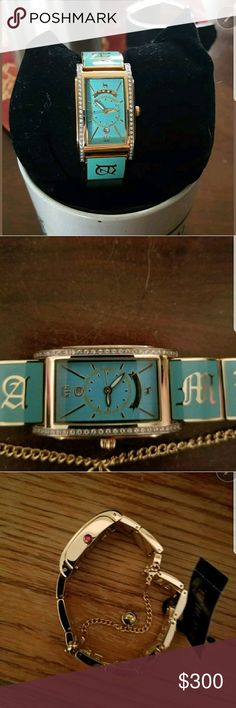 L.A.M.B. Teal Link Watch 🍁 RARE. VERY HARD TO FIND🍁  NWT. This style, this color and NWT is a find. Impossible to find this particular watch.I gave this to my mom for Christmas 2 years ago (maybe 1 yr. ago). She's 80 and said this is two fancy for her. She rarely wears watches now.  No scratches. Never been worn. Absolutely stunning piece. Would be an amazing Christmas gift and addition to any collection.  LAST PHOTO: is for description only.  ✔ Watch tin 🚫 Lowball Offers. They will…