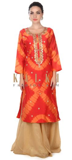 Buy this Peach and coral straight suit with embroidered neckline only on Kalki