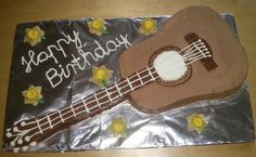 Guitar cake. I used 3 types of creams. Dark brown is Nutella, light brown is ganache finally white is whipping cream.