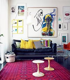 Leather sofa, carpet, wall of art.