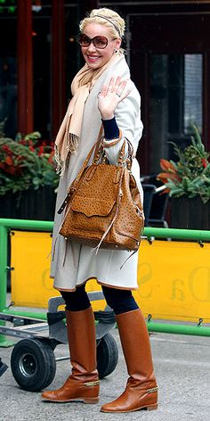 CAMEL BOOTS  Cognac riding boots, like the ones Katherine wears around N.Y.C., are an easy, polished addition to any outfit, plus they go with everything from distressed jeans to a dress.