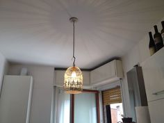 Lampada diametro 20 cm per 30 di altezza creata a partire di una gabbia per uccellini.