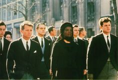 Following President Kennedy's coffin to St. Matthews's Cathedral, Washington D.C., 1963  by Henri Dauman