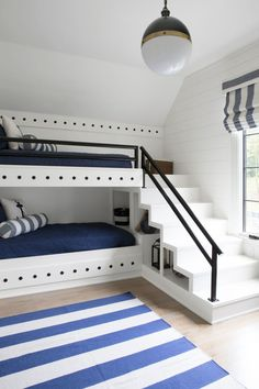 The bunk room, with its navy and white color scheme, is an ode to the homeowners' favorite place: the beach. - Natasha Skolny - - The bunk room, with its navy and white color scheme, is an ode to the homeowners' favorite place: the beach. Unique Bunk Beds, Bunk Beds Built In, Modern Bunk Beds, Bunk Beds With Stairs, Built In Beds For Kids, Custom Bunk Beds, Bunk Bed Rooms, Boys Bunk Bed Room Ideas, Bedrooms