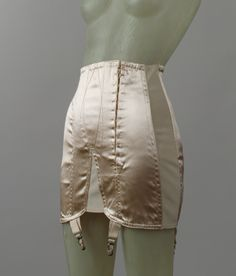 Silk and elastic girdle, American, 1942. This early 1940s girdle shows the transition away from more corsetlike garments over the course of the 1930s.elastic made the sinuous line of the 1930s possible with its flexibility.