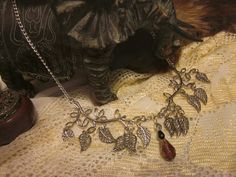 Enchanted Forest Collection Forest Twilight: silver plated leaf necklace with glass crystal drop. $25.00, via Etsy.