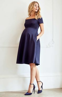 The ultimate occasion dress for maternity glamour – Aria is simply breathtaking in our rich new navy satinesque fabric. Channelling starlet beauty with a Bardot neckline that sits just off the shoulder and a sleek skirt that falls perfectly at the knee. - Maternity Dresses to Wear During Pregnancy - Baby Bump Fashion