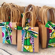 Image of African gift bag made from brown paper and wax print x 10 African Wedding Theme, African Interior Design, African Fabric, African Cake, African Shop, African Crafts, African Accessories, Fabric Gift Bags, Creative Textiles