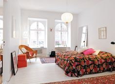 Pretty boho chic bedroom. Fresh whitewash, vibrant linen, Persian rugs, modern eclectic decor.