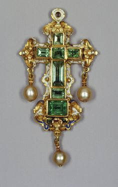 Emerald cross, Indian, circa late 16th century. Obverse: cross formed of seven emeralds in varying shaped table-cuts and box settings. Along the side panels is a frieze in black enamel with a stylised leaf pattern. The cross is inserted into a white enamel frame with opaque blue, translucent green scrollwork and strapwork and a translucent red enamel rosette. With integrated white enamel suspension loop and three pearl pendants.